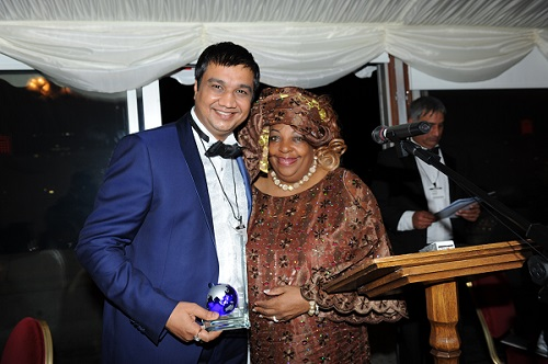 Arun Panchariya accepts the Africa Business Relations Award from Dr. Toni Luck, Founder of the African Legacy Luck